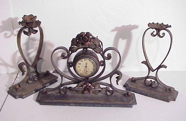 "19: Antique tole clock garniture set, clock is 9  1/2""h"