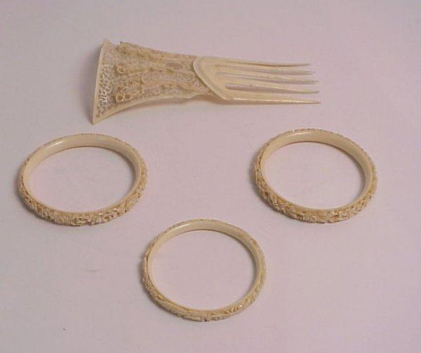 26: Chinese carved bone haircomb and three bangle  brac