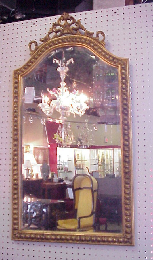 "22: Gilt arch top beveled mirror, mid 20thc, 41"" x 21"""