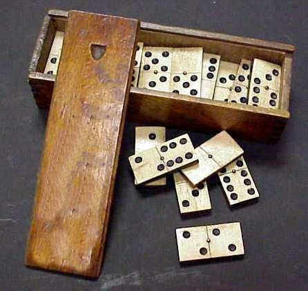 2391A: SET OF EBONY AND BONE OR IVORY DOMINOES IN WOODE