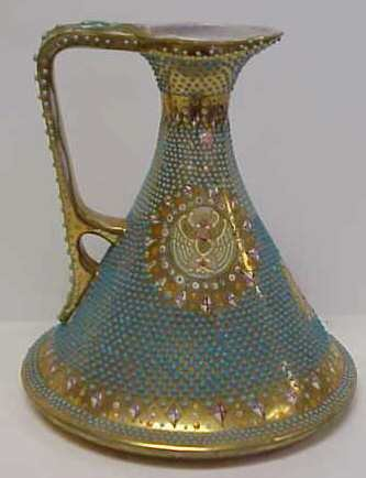 3016: EARLY JEWELLED PORCELAIN EWER, MISSING SOME TURQU