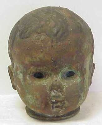 "1011: BRONZE BABY HEAD (MOLD FOR DOLLS HEADS), 7"" X 5 1"