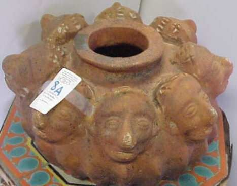 2008A: TERRA COTTA CENTERPIECE DECORATED WITH FACES.