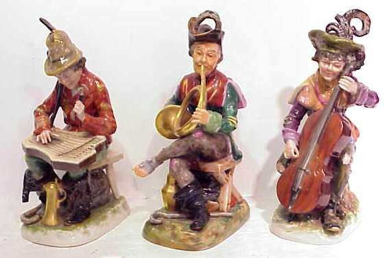 6: 3 PORCELAIN FIGURES PLAYING MUSICAL INSTRUMENTS, CAP