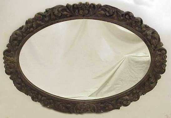 """22: 19/20THC OVAL HEAVILY CARVED WOOD WALL MIRROR, 40"""""""