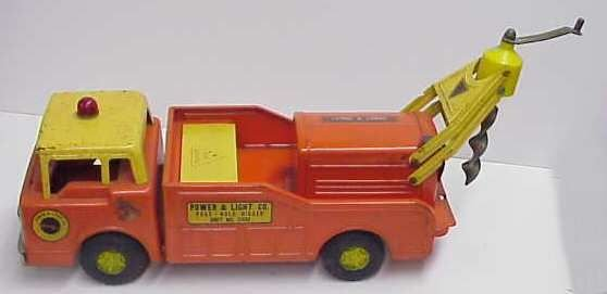 2009A: NYLINT TOY METAL TRUCK,, POST HOLE DIGGER