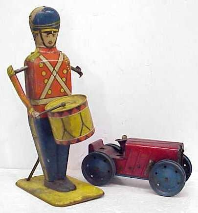 14: 2 OLD TIN TOYS, NO 27 DRUM MAJOR MADE BY WOLVERINE,