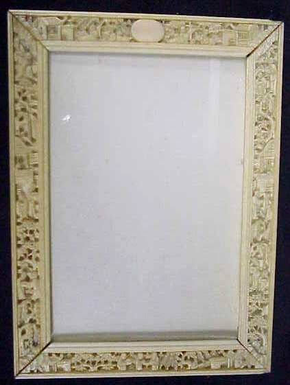 28: CARVED BONE FIGURAL PICTURE FRAME, CHIP IN TOP RIGH