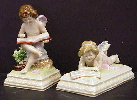 17: TWO GERMAN PORCELAIN CUPID FIGURINES
