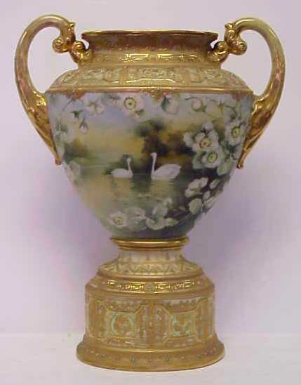 2126: NIPPON FOOTED URN. HAND PAINTED GOLD SCROLLWORK A