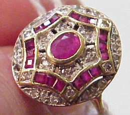 38: 14K DIAMOND AND RUBY ROUND RING