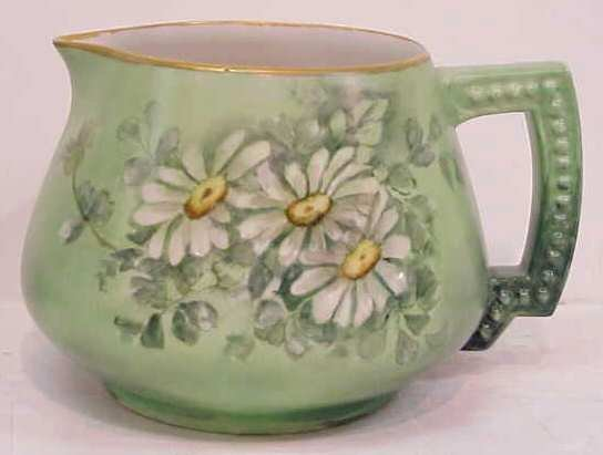 22A: LIMOGES PORCELAIN PITCHER HAND PAINTED WITH DAISIE
