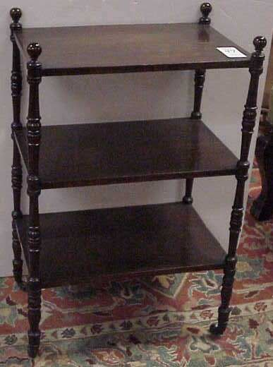 1047: MAHOGANY SIDE TABLE, 3 TIERS, ON CASTERS
