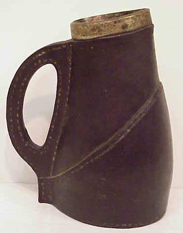 17: DOULTON LEATHER LOOK POTTERY PITCHER WITH STERLING