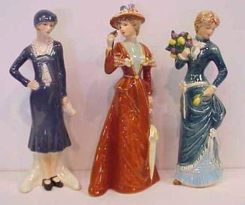 22A: THREE GOEBEL LADY FIGURINES