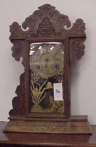 1036: SESSIONS VICTORIAN OAK GINGERBREAD CLOCK