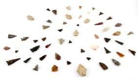 FIFTY-TWO FLAKED-STONE ARROW POINTS IN A DISPLAY