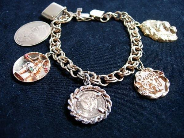 90153: 14K GOLD CHARM BRACELET 2 1/2 PESO COIN 52.2G