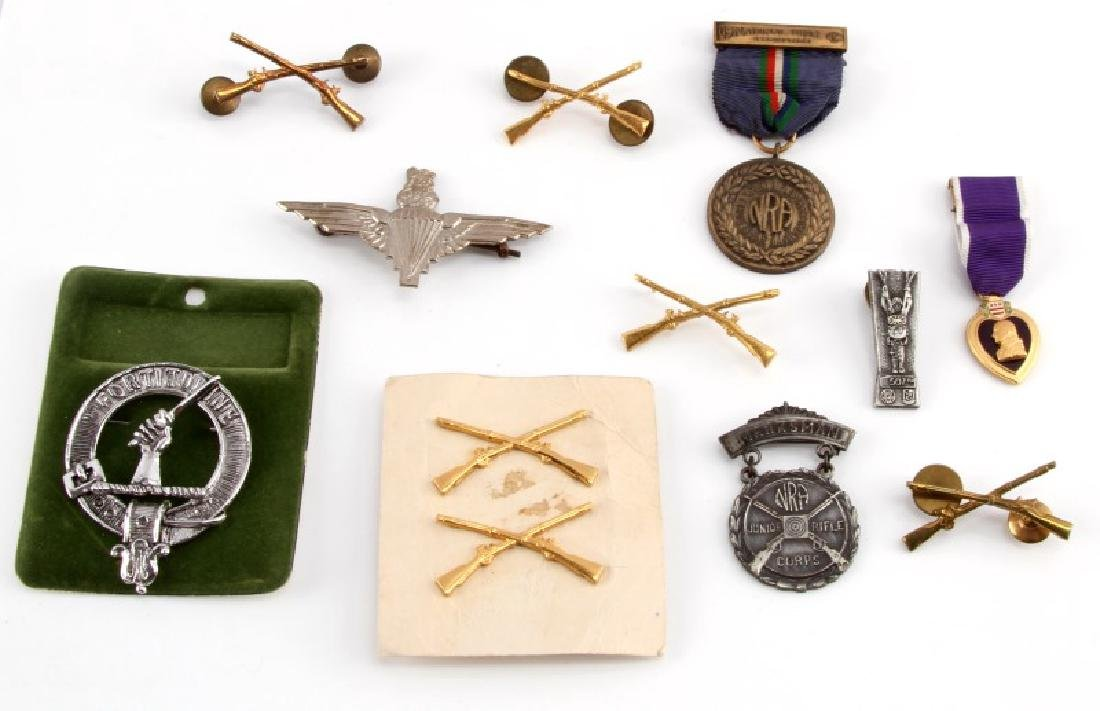 ASSORTED MILITARY NRA BADGES & PURPLE HEART