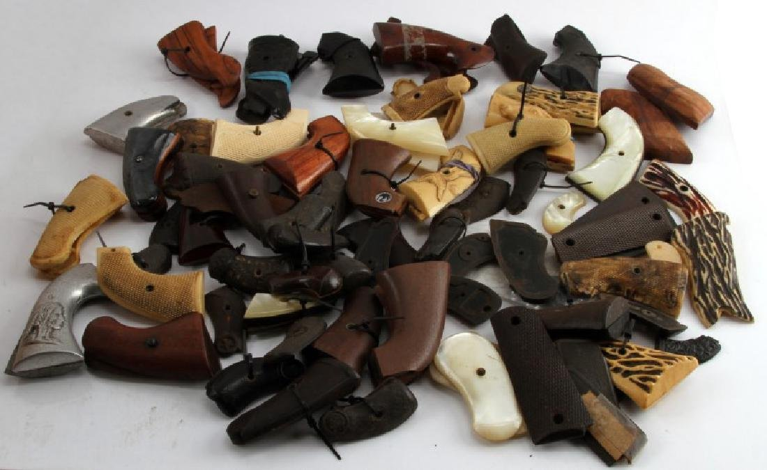 LOT OF 60 PLUS SA  AND DA REVOLVER AND 1911 GRIPS