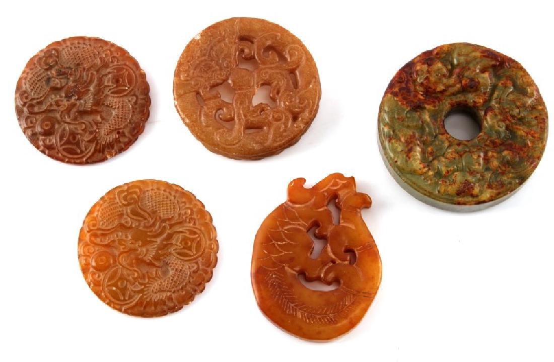 5 VARIOUS ROUND MULTICOLOR CARVED JADE PENDANTS