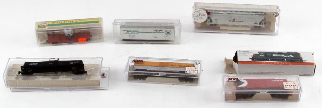 ASSORTED MINIATURE N GAUGE TOY TRAIN LOT OF 7