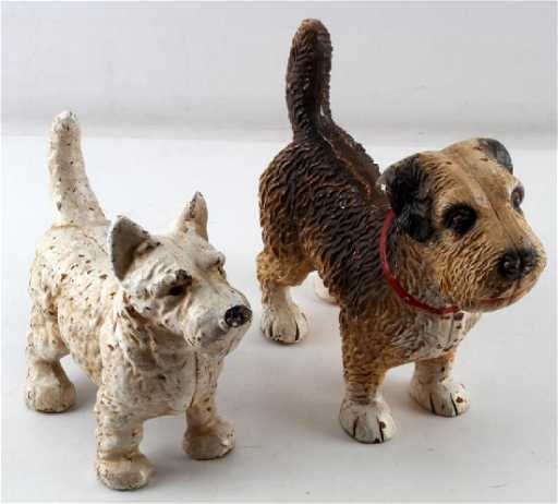 - ANTIQUE CAST IRON TERRIER DOG DOOR STOPS