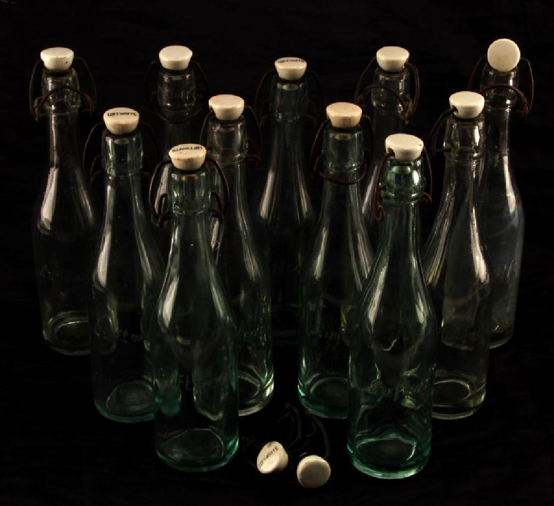 LUFTWAFFE GLASS BOTTLES WITH PORCELAIN TOP LOT 11
