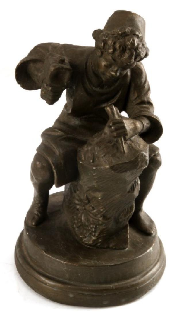 TABLETOP SCULPTURE OF BOY CHISELING AT STONE