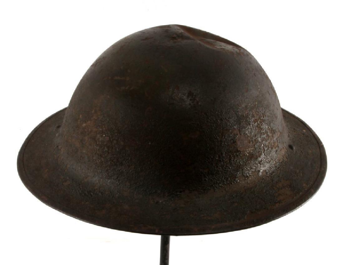 WWI BRITISH BATTLE DAMAGED STEEL BRODIE HELMET