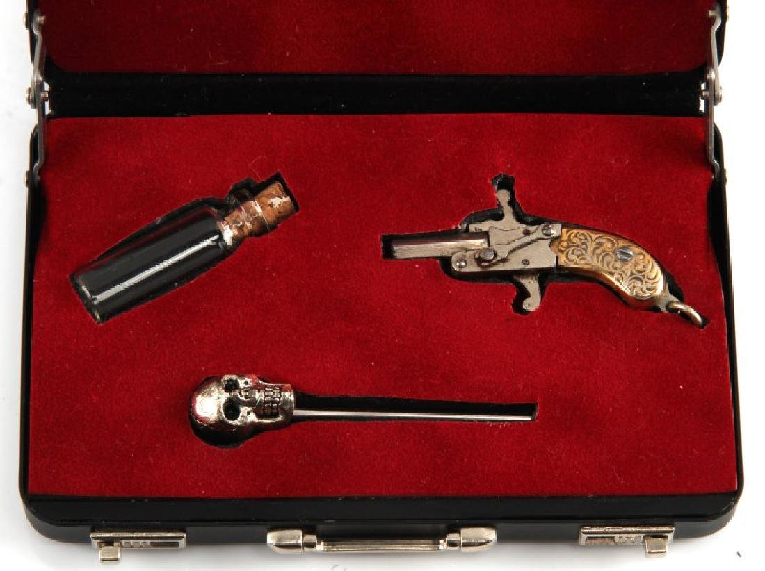 2MM PIN GUN WITH SKULL PIN AND VIAL LOT - 2