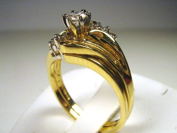 .60CT  BRILLIANT ROUND WITH BAGUETTES DIAMOND SET