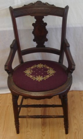 TWO MATCHING UPHOLSTERED ARM CHAIRS