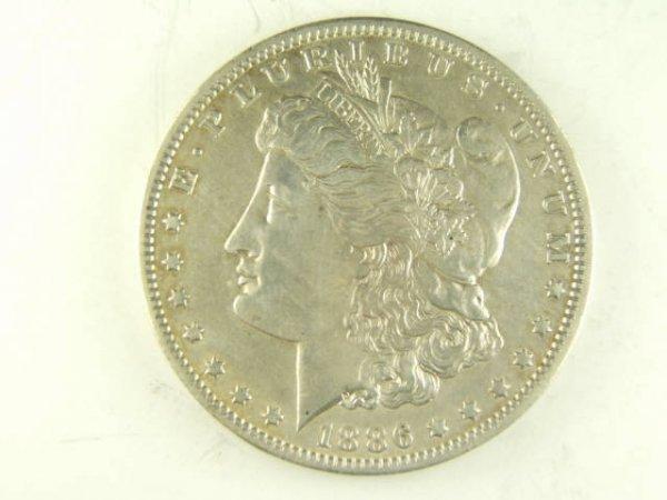 """1886-O MORGAN SILVER DOLLAR VAM-1A """"E"""" REV TOP 100"""