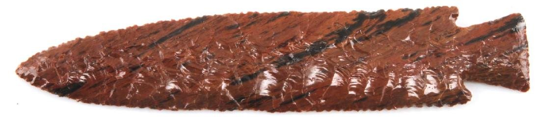 LACQUERED RED BROWN STONE ARROWHEAD STRIATED