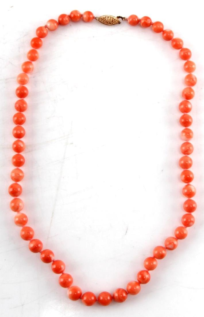 7MM LIGHT CORAL NECKLACE WITH 14KT GOLD CLASP