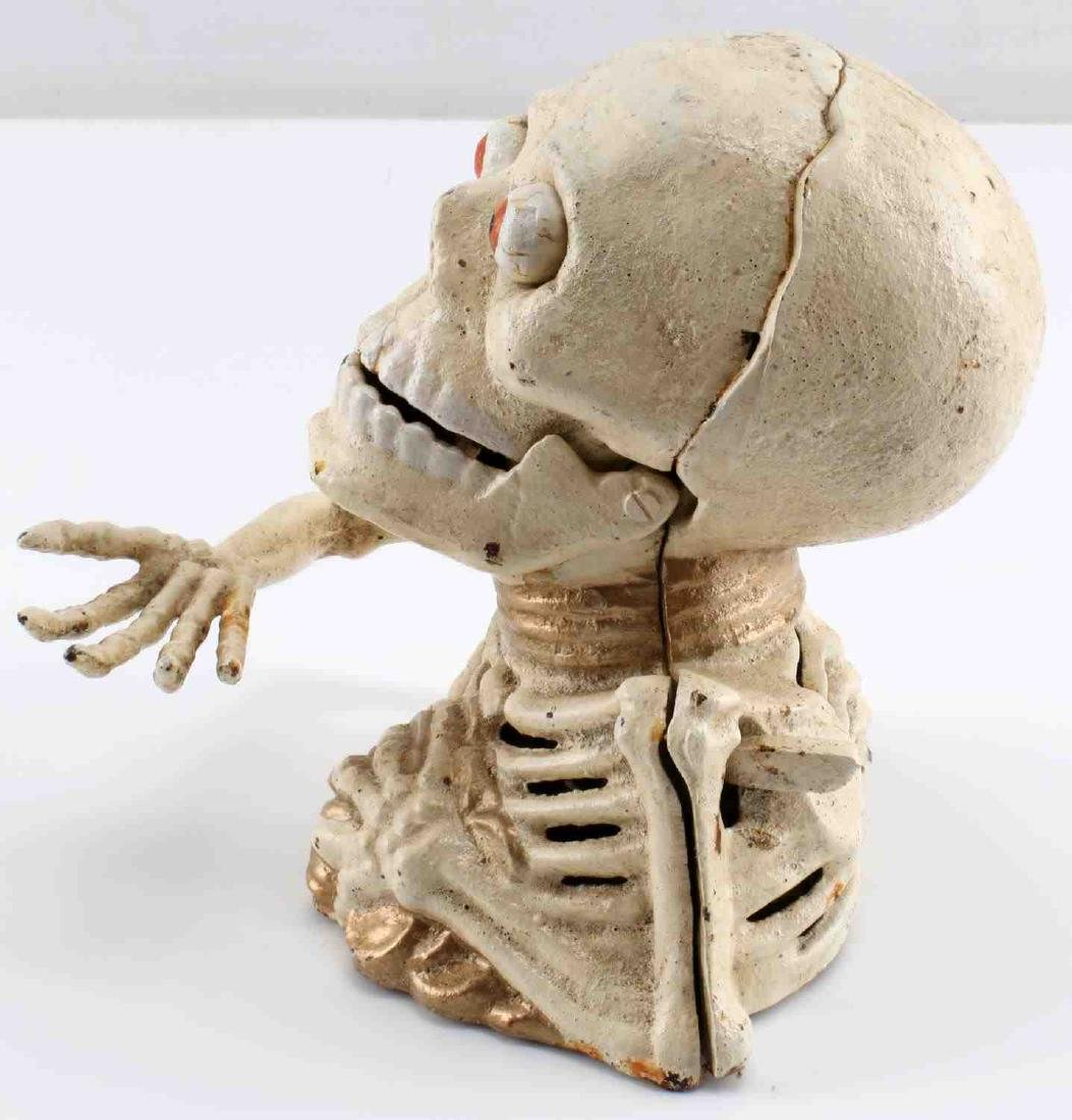 CAST IRON SKELETON HOLDING COINS MECHANICAL BANK - 2