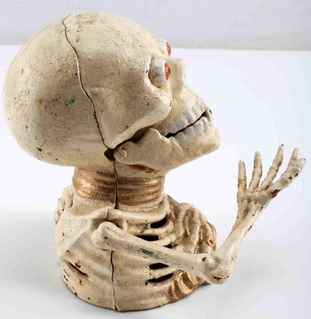 CAST IRON SKELETON HOLDING COINS MECHANICAL BANK - 4
