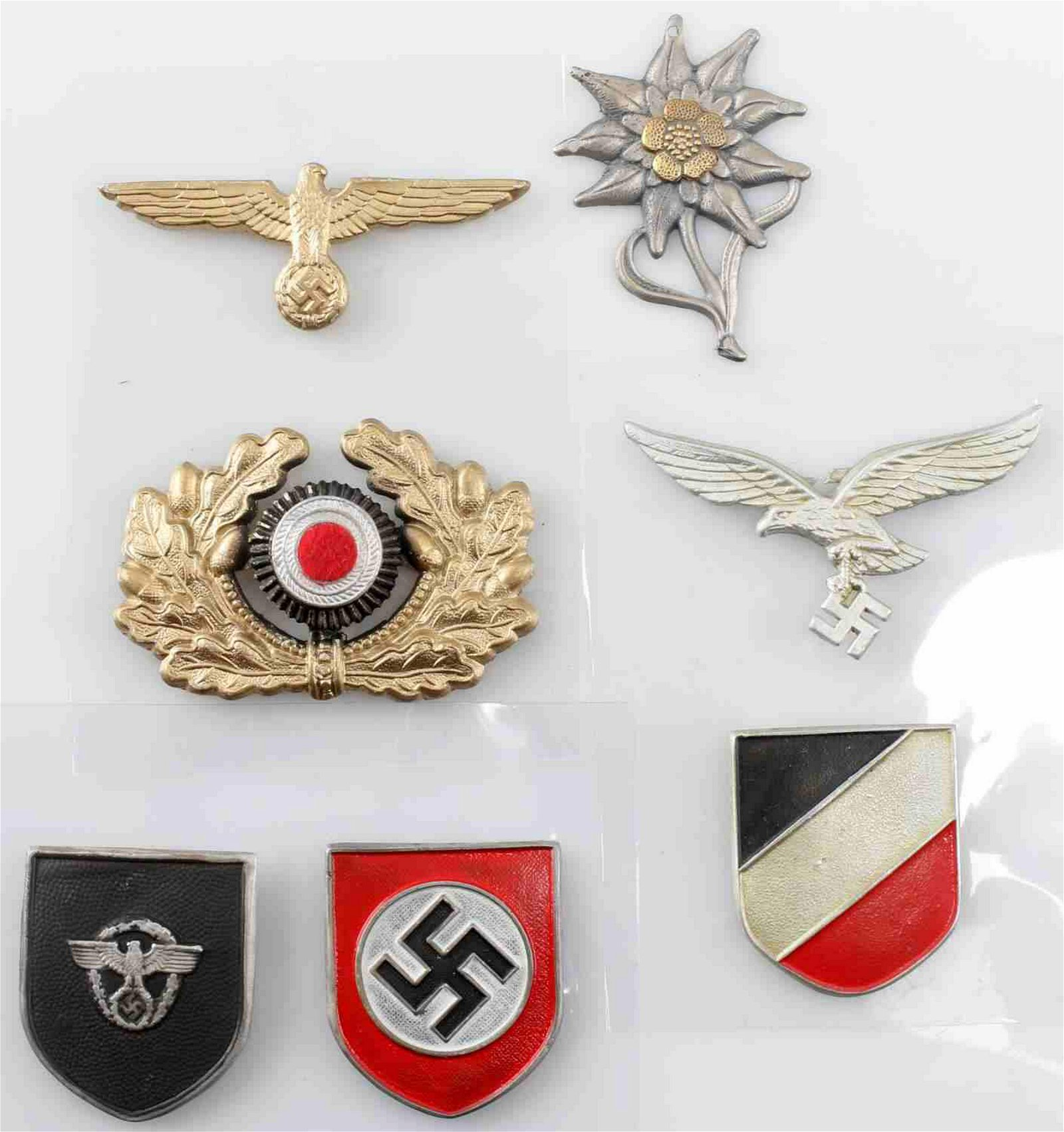 WWII GERMAN THIRD REICH CAP BADGE LOT OF SEVEN