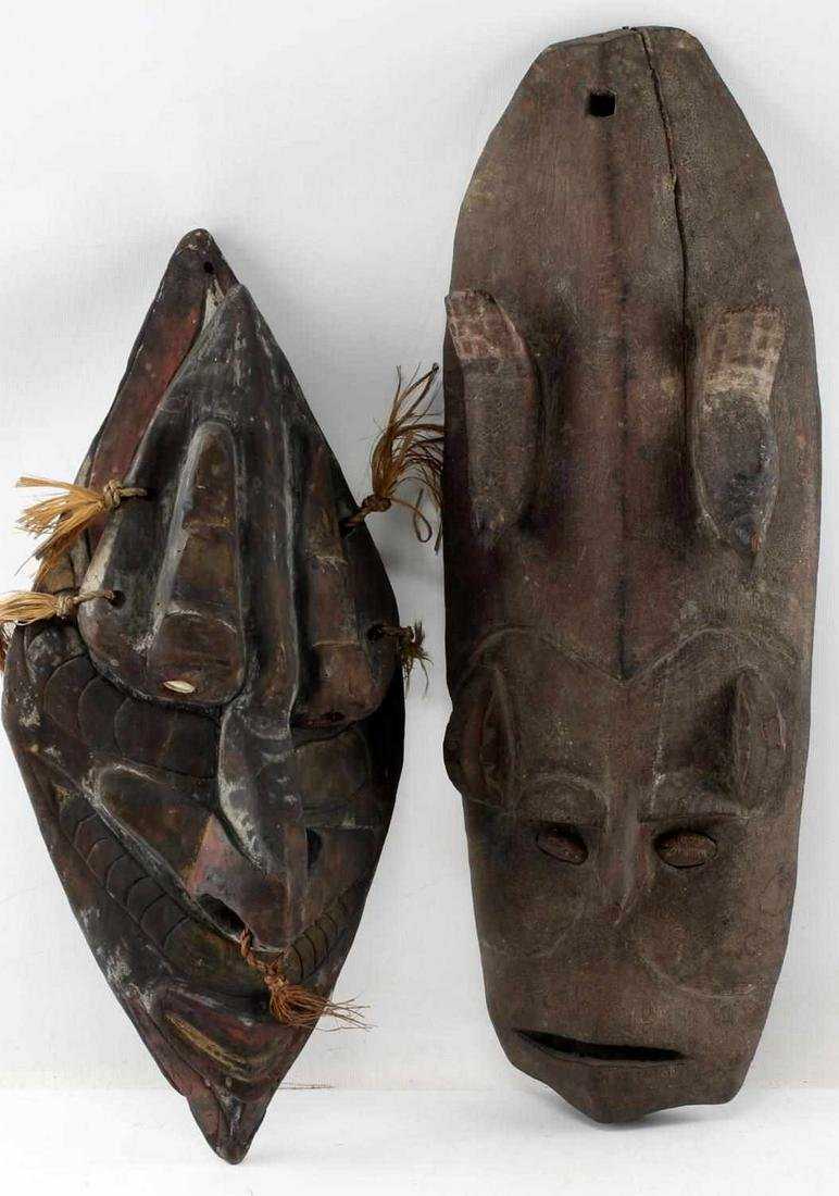 LOT OF TWO CARVED SHIELD  SHAPED AFRICAN MASKS