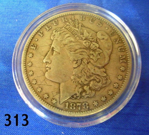 40313: US 1878 CC MORGAN SILVER DOLLAR VF - DAMAGED