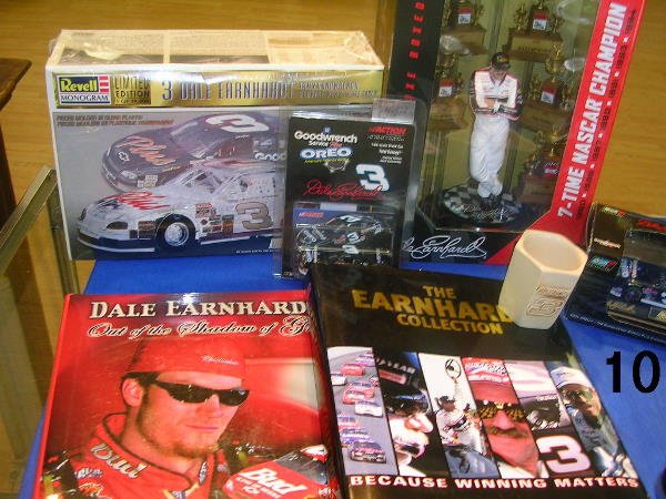 6010: DALE EARNHARDT LOT BOOK LARGE CAR TROPHY STAND