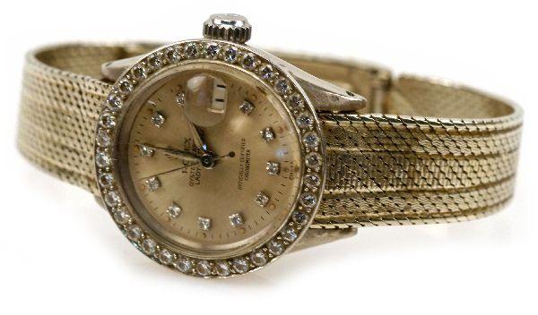 LADIES 18K ROLEX DATEJUST DIAMOND BEZEL WATCH