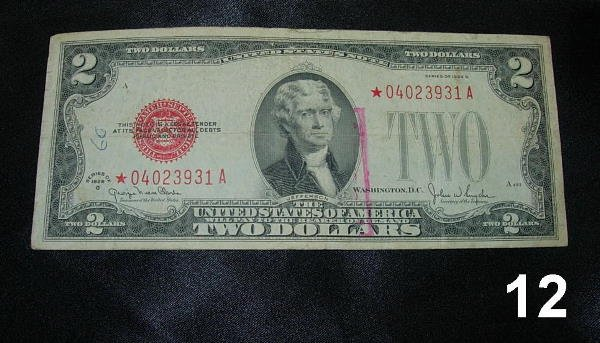 2012: $2.00 1928 G STAR NOTE 04023931A F WITH INK STAIN