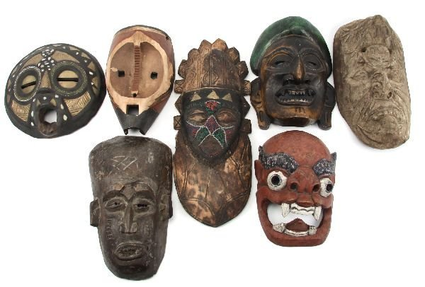GROUPING OF SEVEN TRIBAL MASKS OF VARIOUS ORIGINS
