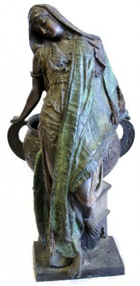 WHITE METAL SCULPTURE OF A WOMAN WITH PLANTER