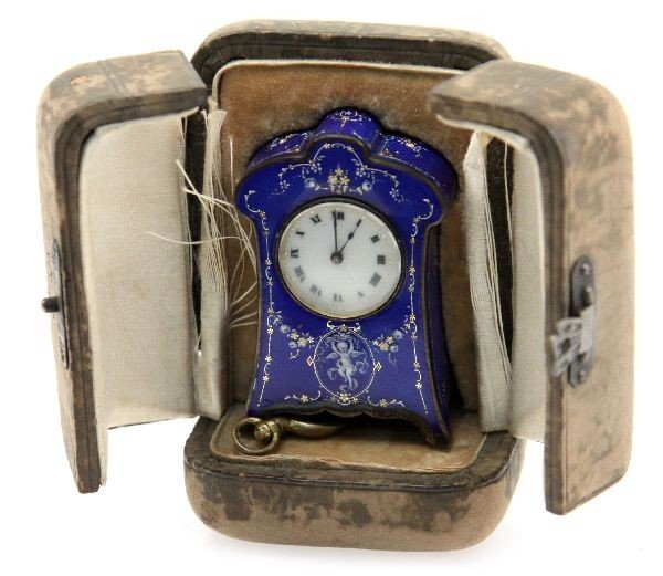 MINIATURE ARGENT DORE CLOCK IN FITTED CARRY CASE