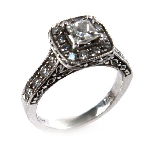 WHITE GOLD PRINCESS CUT DIAMOND SET IN PAVE.