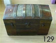 129: ANTIQUE HUMPBACK TRUNK EMBOSSED TIN OVER WOOD BRAS