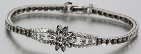 LADIES 14K WHITE GOLD AND DIAMOND BRACELET